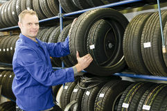 man-in-the-tire-store-with-a-tire
